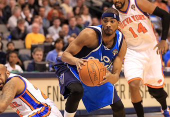 DALLAS, TX - MARCH 10:  Forward Corey Brewer #13 of the Dallas Mavericks steals the ball from Anthony Carter #25 of the New York Knicks at American Airlines Center on March 10, 2011 in Dallas, Texas.  NOTE TO USER: User expressly acknowledges and agrees t