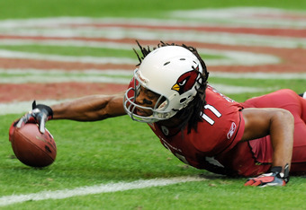 GLENDALE, AZ - DECEMBER 11:  Larry Fitzgerald #11 of the Arizona Cardinals dives into the endzone against the San Francisco 49ers at University of Phoenix Stadium on December 11, 2011 in Glendale, Arizona. Arizona won 21-19.  (Photo by Norm Hall/Getty Ima