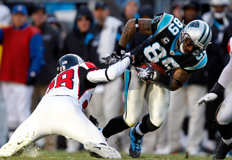 CHARLOTTE, NC - DECEMBER 11:  Steve Smith #89 of the Carolina Panthers is tackled by Kelvin Hayden #26 of the Atlanta Falcons during their game at Bank of America Stadium on December 11, 2011 in Charlotte, North Carolina.  (Photo by Streeter Lecka/Getty I