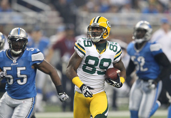 DETROIT, MI - NOVEMBER 24: James Jones #89 of the Green Bay Packers scores a third-quarter touchdown on a 65-yard pass from teammate Aaron Rodgers #12 during the third quarter of the game against the Detroit Lions at Ford Field on November 24, 2011 in Det