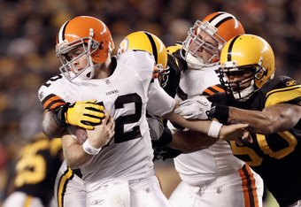 PITTSBURGH, PA - DECEMBER 08:  Colt McCoy #12 of the Cleveland Browns attempts to break away from the grasp of Larry Foote #50 of the Pittsburgh Steelers at Heinz Field on December 8, 2011 in Pittsburgh, Pennsylvania.  (Photo by Jared Wickerham/Getty Imag