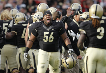 WEST LAFAYETTE, IN - NOVEMBER 12: Eric McDaniel #56 of the Purdue Boilermakers celebrates with teammates after the defense blocked an extra point attempt in the fourth quarter against the Ohio State Buckeyes at Ross-Ade Stadium on November 12, 2011 in Wes