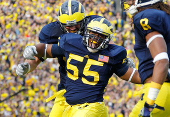 ANN ARBOR, MI - NOVEMBER 26:  Jibreel Black #55 of the Michigan Wolverines reacts after a third down stop while playing the Ohio State Buckeyes at Michigan Stadium on November 26, 2011 in Ann Arbor, Michigan. Michigan won the game 40-34. (Photo by Gregory