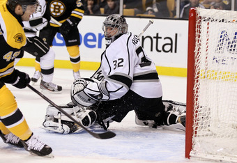 BOSTON, MA - DECEMBER 13:  Jonathan Quick #32 of the Los Angeles Kings is unable to stop a shot by Rich Peverley #49 of the Boston Bruins in the first period on December 13, 2011 at TD Garden in Boston, Massachusetts.  (Photo by Elsa/Getty Images)