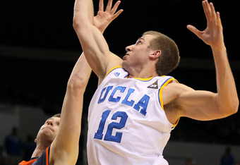 LOS ANGELES, CA - NOVEMBER 28:  David Wear #12 of the UCLA Bruins grabs a rebound over Corbin Moore #44 of the Pepperdine Waves at LA Sports Arena on November 28, 2011 in Los Angeles, California.  (Photo by Stephen Dunn/Getty Images)