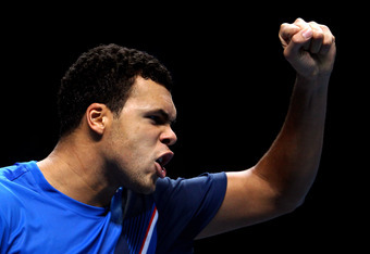 LONDON, ENGLAND - NOVEMBER 27:  Jo-Wilfried Tsonga of France celebrates a point during the men's final singles match against Roger Federer of Switzerland during the Barclays ATP World Tour Finals at the O2 Arena on November 27, 2011 in London, England.  (