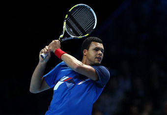 LONDON, ENGLAND - NOVEMBER 27:  Jo-Wilfried Tsonga of France hits the ball during the men's final singles match against Roger Federer of Switzerland during the Barclays ATP World Tour Finals at the O2 Arena on November 27, 2011 in London, England.   (Phot