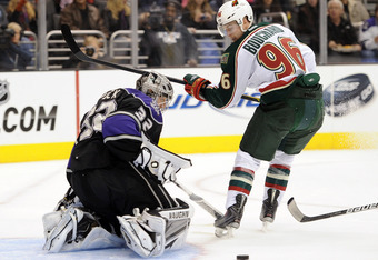 LOS ANGELES, CA - DECEMBER 08:  Jonathan Quick #32 of the Los Angeles Kings makes a stop of Pierre-Marc Bouchard #96 of the Minnesota Wild on a breakaway during the first period at Staples Center on December 8, 2011 in Los Angeles, California.  (Photo by