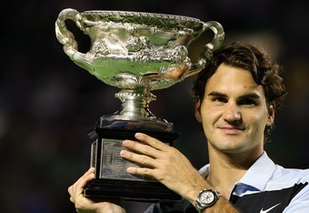 MELBOURNE, AUSTRALIA - JANUARY 28:  Roger Federer of Switzerland holds the trophy after winning his men's final match against Fernando Gonzalez of Chile on day fourteen of the Australian Open 2007 at Melbourne Park on January 28, 2007 in Melbourne, Austra