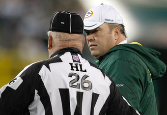 GREEN BAY, WI - DECEMBER 11: Head coach Mike McCarthy of the Green Bay Packers argues with referee Mark Blatz #26 during the game against the Oakland Raiders at Lambeau Field on December 11, 2011 in Green Bay, Wisconsin. The Packers defeated the Raiders 4