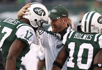 EAST RUTHERFORD, NJ - NOVEMBER 27: New York Jets offensive coordinator  Brian Schottenheimer celebrates with  Plaxico Burress #17 and Santonio Holmes #10 of the New York Jets during their game against the Buffalo Bills at MetLife Stadium on November 27, 2