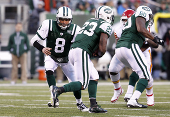 EAST RUTHERFORD, NJ - DECEMBER 11:  Mark Brunell #8 hands off to Shonn Greene #23 of the New York Jets during a game against the Kansas City Chiefs at MetLife Stadium on December 11, 2011 in East Rutherford, New Jersey.  (Photo by Jeff Zelevansky/Getty Im