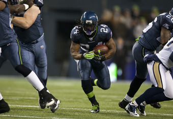 SEATTLE, WA - DECEMBER 12:  Marshawn Lynch #24 of the Seattle Seahawks runs with the ball during a game against the St. Louis Rams at CenturyLink Field December 12, 2011 in Seattle, Washington. Seattle won 33-13. (Photo by Jay Drowns/Getty Images)