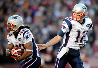 LANDOVER, MD - DECEMBER 11:   Tom Brady #12 of the New England Patriots hands the ball off to  BenJarvus Green-Ellis #42 of the New England Patriots during a game against the Washington Redskins at FedExField on December 11, 2011 in Landover, Maryland.  (