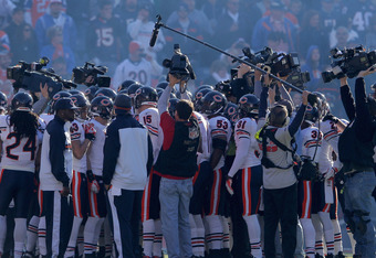 DENVER, CO - DECEMBER 11:  The Chicago Bears huddle up in the view of television cameras as they prepare to face the Denver Broncos at Sports Authority Field at Mile High on December 11, 2011 in Denver, Colorado. The Broncos defeated the Bears 13-10 in ov