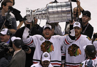 PHILADELPHIA - JUNE 09:  Marian Hossa #81 of the Chicago Blackhawks hoists the Stanley Cup after teammate Patrick Kane #88 scored the game-winning goal in overtime to defeat the Philadelphia Flyers 4-3 and win the Stanley Cup in Game Six of the 2010 NHL S