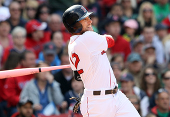 BOSTON, MA - MAY 08:  Jed Lowrie #12 of the Boston Red Sox hits a 2RBI double in the seventh inning against the Minnesota Twins on May 8, 2011 at Fenway Park in Boston, Massachusetts.  (Photo by Elsa/Getty Images)