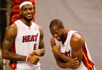 MIAMI, FL - DECEMBER 12: LeBron James #6 and Dwyane Wade #3 of the Miami Heat laugh during media day at American Airlines Arena on December 12, 2011 in Miami, Florida.  (Photo by Mike Ehrmann/Getty Images)