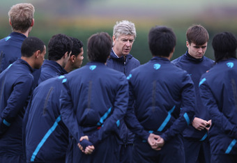 ST ALBANS, ENGLAND - OCTOBER 31:  Arsene Wenger of Arsenal gives a team talk during a training session ahead of their UEFA Champions League Group match against Olympique de Marseille at London Colney on October 31, 2011 in St Albans, England.  (Photo by C