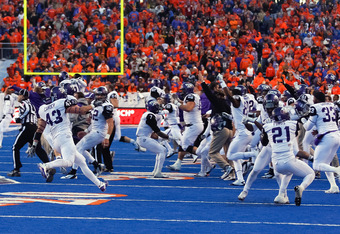 BOISE, ID - NOVEMBER 12:  The TCU Horned Frogs celebrate their 36-35 win against the Boise State Broncos at Bronco Stadium on November 12, 2011 in Boise, Idaho.  (Photo by Otto Kitsinger III/Getty Images)