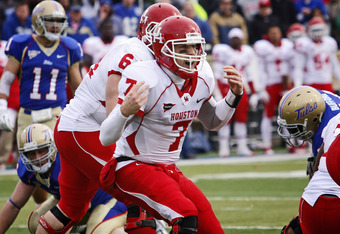 TULSA, OK - NOVEMBER 25:  Quarterback Case Keenum #7 of the Houston Cougars yells a play at the line of scrimmage in the second half against the Tulsa Hurricanes November 25, 2011 at H.A. Chapman Stadium in Tulsa, Oklahoma.  Houston defeated Tulsa 48-16.