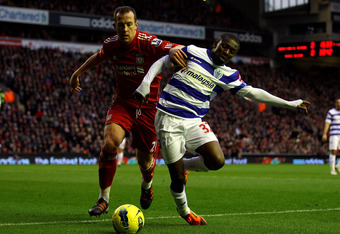 LIVERPOOL, ENGLAND - DECEMBER 10:  Charlie Adam of Liverpool tussles for posession with Shaun Wright-Phillips of Queens Park Rangers during the Barclays Premier League match between Liverpool and Queens Park Rangers at Anfield on December 10, 2011 in Live