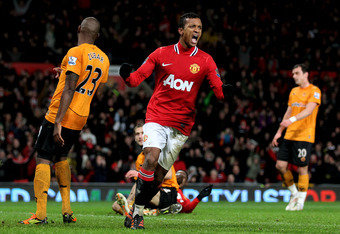 MANCHESTER, ENGLAND - DECEMBER 10:  Nani of Manchester United celebrates after scoring his team's third goal during the Barclays Premier League match between Manchester United and Wolverhampton Wanderers at Old Trafford on December 10, 2011 in Manchester,