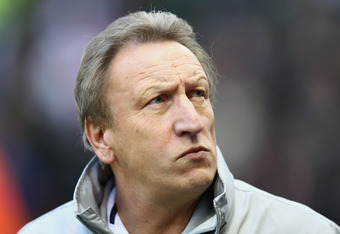 STOKE ON TRENT, ENGLAND - NOVEMBER 19:  Neil Warnock of Queens Park Rangers looks on befored the Barclays Premier League match between Stoke City and Queens Park Rangers at Britannia Stadium on November 19, 2011 in Stoke on Trent, England.  (Photo by Cliv