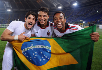 ROME, ITALY - MAY 07:  07:  Thiago Silva and Pato and Robinho of Milan celebrate the victory after the Serie A match between AS Roma and AC Milan at Stadio Olimpico on May 7, 2011 in Rome, Italy.  (Photo by Giuseppe Bellini/Getty Images)