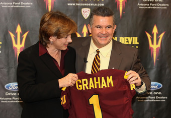 TEMPE, AZ - DECEMBER 14:  Head coach Todd Graham (R) of the Arizona State Sun Devil poses with Vice President for Athletics Lisa Love (L) at a press conference introducing him as the new head football coach at Sun Devil Stadium on December 14, 2011 in Tem