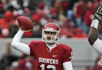 NORMAN, OK - NOVEMBER 26:  Quarterback Landry Jones #12 of the Oklahoma Sooners looks to throw in the first half against the Iowa State Cyclones on October 26, 2011 at Gaylord Family-Oklahoma Memorial Stadium in Norman, Oklahoma. Oklahoma defeated Iowa St