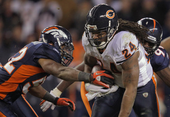 DENVER, CO - DECEMBER 11:  Linebacker Wesley Woodyard #52 of the Denver Broncos strips the ball from running back Marion Barber #24 of the Chicago Bears causing a fumble which was recovered by Elvis Dumervil of the Denver Broncos in overtime at Sports Aut