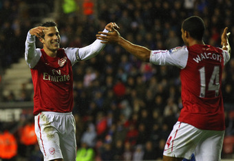WIGAN, ENGLAND - DECEMBER 03:  Robin Van Persie of Arsenal celebrates with Theo Walcott after scoring the fourth goal during the Barclays Premier League match between Wigan Athletic and Arsenal at the DW Stadium on December 3, 2011 in Wigan, England.  (Ph