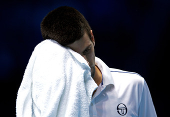 LONDON, ENGLAND - NOVEMBER 25:  Novak Djokovic of Serbia reacts as he heads towards defeat during the men's singles match against Janko Tipsarevic of Serbia during the Barclays ATP World Tour Finals at the O2 Arena on November 25, 2011 in London, England.