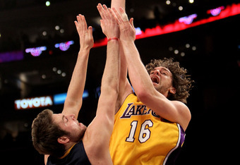 LOS ANGELES, CA - MARCH 02:  Pau Gasol #16 of the Los Angeles Lakers shoots over Josh McRoberts #32 of the Indiana Pacers on March 2, 2010 at Staples Center in Los Angeles, California. The Lakers won 122-99.  NOTE TO USER: User expressly acknowledges and