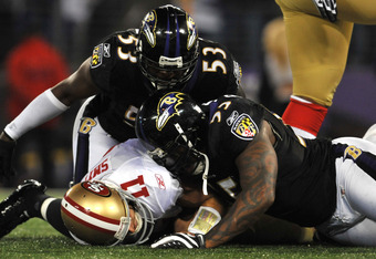 BALTIMORE - NOVEMBER 24:  Jameel McClain #53 and Terrell Suggs #55 of the Baltimore Ravens sack Alex Smith #11 of the San Francisco 49ers at M&T Bank Stadium on November 24, 2011 in Baltimore, Maryland.  (Photo by Larry French/Getty Images)