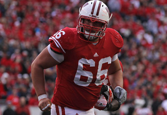 MADISON, WI - SEPTEMBER 24: Peter Konz #66 of the Wisconsin Badgers moves to block against the South Dakota Coyotes at Camp Randall Stadium on September 24, 2011 in Madison Wisconsin. Wisconsin defeated South Dakota 59-10.(Photo by Jonathan Daniel/Getty I
