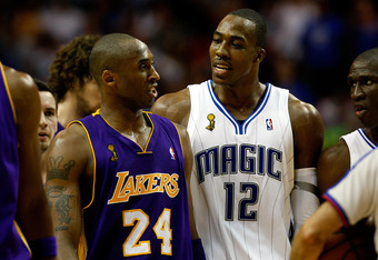 ORLANDO, FL - JUNE 11:  Kobe Bryant #24 of the Los Angeles Lakers and Dwight Howard #12 of the Orlando Magic exchange words in the second half of Game Four of the 2009 NBA Finals on June 11, 2009 at Amway Arena in Orlando, Florida.  NOTE TO USER:  User ex