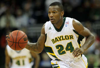 KANSAS CITY, MO - MARCH 09:  LaceDarius Dunn #24 of the Baylor Bears controls the ball against the Oklahoma Sooners during their game in the first round of the 2011 Phillips 66 Big 12 Men's Basketball Tournament at Sprint Center on March 9, 2011 in Kansas