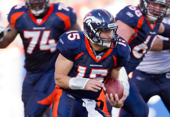 DENVER, CO - DECEMBER 11:  Quarterback Tim Tebow #15 of the Denver Broncos runs with the ball against the Chicago Bears at Sports Authority Field at Mile High on December 11, 2011 in Denver, Colorado. (Photo by Justin Edmonds/Getty Images)