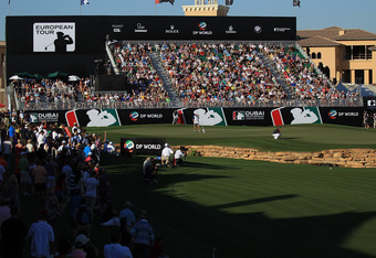 Mens' Golf: Dubai World Championships, 18th Hole on the Final Day of Competition, Dec. 11, 2011. Notice the grandstands and fans surrounding the fairway and green.