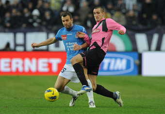 TURIN, ITALY - DECEMBER 18: Giorgio Chiellini of Juventus FC competes with Riccardo Meggiorini of Novara Calcio during the Serie A match between Juventus FC and Novara Calcio at Juventus Arena on December 18, 2011 in Turin, Italy.  (Photo by Valerio Penni