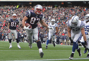 FOXBORO, MA - DECEMBER 4:   Rob Gronkowski #87 of the New England Patriots beats  A.J. Edds #52 of the Indianapolis Colts for his third touch during the second half at Gillette Stadium on December 4, 2011 in Foxboro, Massachusetts.   (Photo by Jim Rogash/