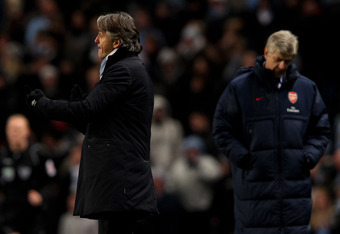 MANCHESTER, ENGLAND - DECEMBER 18:  Manchester City Manager Roberto Mancini issues instructions during the Barclays Premier League match between Manchester City and Arsenal at the Etihad Stadium on December 18, 2011 in Manchester, England.  (Photo by Alex