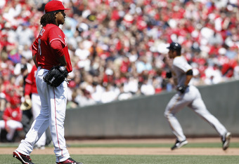 CINCINNATI, OH - APRIL 17: Edinson Volquez #36 of the Cincinnati Reds reacts after giving up a solo home run in the sixth inning to Garrett Jones #46 of the Pittsburgh Pirates at Great American Ball Park on April 17, 2011 in Cincinnati, Ohio. The Pirates