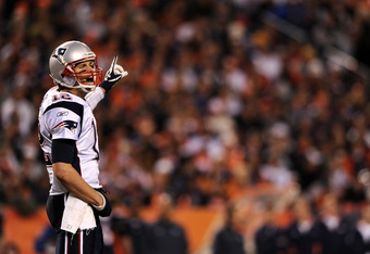 DENVER, CO - DECEMBER 18: Quarterback Tom Brady #12 of the New England Patriots calls out a play against the Denver Broncos in the third quarter at Sports Authority Field at Mile High on December 18, 2011 in Denver, Colorado. The New England Patriots won,