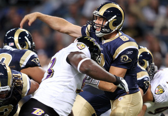 ST LOUIS, MO - SEPTEMBER 25:  Quarterback Sam Bradford #8 of the St. Louis Rams hit after releasing the ball during the game against the Baltimore Ravens on September 25, 2011 at the Edward Jones Dome in St Louis, Missouri.  (Photo by Jamie Squire/Getty I