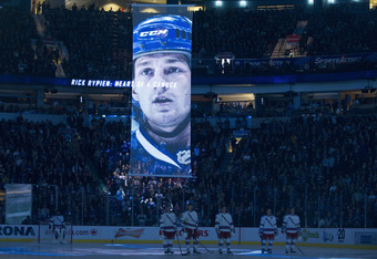 VANCOUVER, CANADA - OCTOBER 18: Former Vancouver Canucks Rick Rypien is remembered during an on-ice ceremony prior to the start of NHL action between the Vancouver Canucks and the New York Rangers on October 18, 2011 at Rogers Arena in Vancouver, British