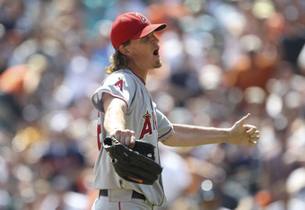 DETROIT - JULY 31:  Jered Weaver #36 of the Los Angeles Angels of Anaheim yells into the Tigers dugout after being throw out of the game by homeplate umpire Hunter Wendelstedt  for throwing a pitch close to Alex Avila #13 of the   Detroit Tigers after Car