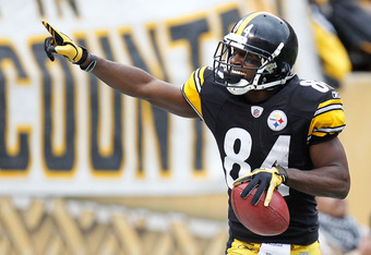 PITTSBURGH, PA - DECEMBER 04:  Antonio Brown #84 of the Pittsburgh Steelers celebrates a second quarter punt return for a touchdown while playing the Cincinnati Bengals at Heinz Field on December 4, 2011 in Pittsburgh, Pennsylvania.  (Photo by Gregory Sha